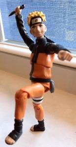 "4"" Uzumaki Naruto Action Figure poised for action!"